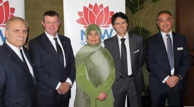Andrew Penfold [2nd left], Maha Krayem Abdo and Victor Dominello