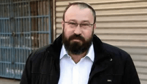 Rabbi Achiad Ettinger, father of 12 who fired back at Ariel terrorist, is laid to rest