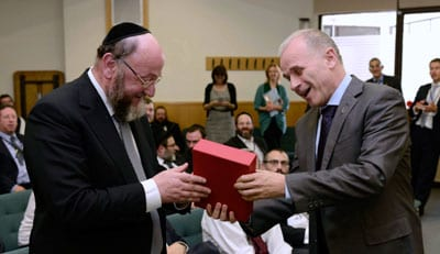 Hebrew University Rector, Prof. Asher Cohen presents Chief Rabbi Ephraim Mirvis with a copy of the Hebrew University's Crown Bible. (Photo: Office of the Chief Rabbi)