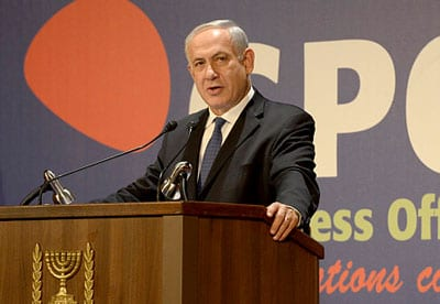 Benjamin Netanyahu addresses the international media.  Photo: Amos Ben Gershon/GPO