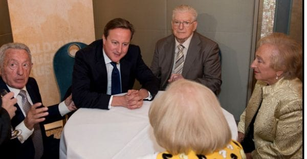 David Cameron with survivors