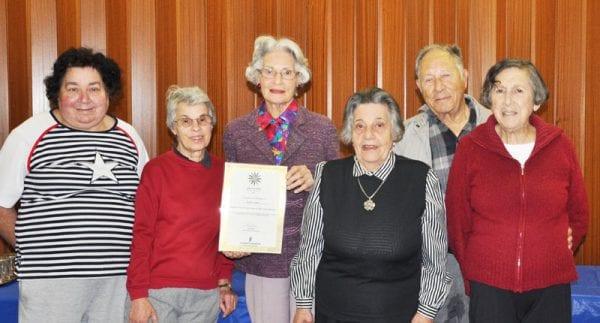 Dorothy shows her award