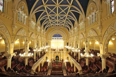Sydney's Great Synagogue was designed by Thomas Rowe in 1875 and built in 1878. It is acknowledged as one of Sydney's most beautiful heritage buildings. The Great Synagogue has remained the Jewish cathedral of Sydney, though today high-rise buildings on either side tend to squash its exterior majesty. The growth of the Jewish community and its suburban dispersal has brought the establishment of many other synagogues but The Great has retained its stateliness and solemnity, while its busy program of services and activities is supported by a loyal congregation and provides, together with the city churches of other denominations, a serene spiritual oasis in the midst of the bustling life of the city.