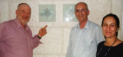 Yitzhak Treister, Michael Kuttner and Tali Dowek looking at a plaque in the lobby of the new tower block at Hadassah Hospital - Ein Karem Campus. The plaque records the support of the Lady Marion Davis Trust.