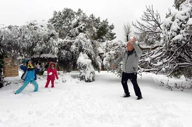 President Reven Rivlin has a new fight on his hands...snowball at ten paces with grandchildren Karni and Ziv.     Photo Haim Zach