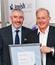 Andrew Blode (right) accepts his Life Governor award from Mike Debinski, Jewish Care President.