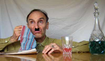 John Grinston as Hitler