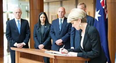 Foreign Minister Julie Bishop signs the book