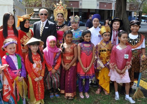 Vic Alhadeff surrounded by children from many cultures