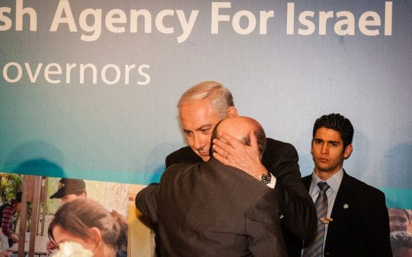Prime Minister Benjamin Netanyahu hugs Chairman of the Executive of The Jewish Agency for Israel, Natan Sharansky, at the Board of Governors of the Jewish Agency in Jerusalem  photo: Dave Bender, The Jewish Agency for Israel