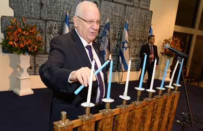 President Rueven Rivlin lights the Menorah  Photo: Mark Neyman