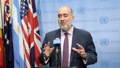"Israeli Ambassador to the U.N. Ron Prosor, pictured here speaking to journalists on July 10 following a U.N. Security Council meeting on the Israel-Hamas war, says it is ""about time Jewish employees at the U.N won't be obligated to work on Yom Kippur."" Credit: UN Photo/Evan Schneider."