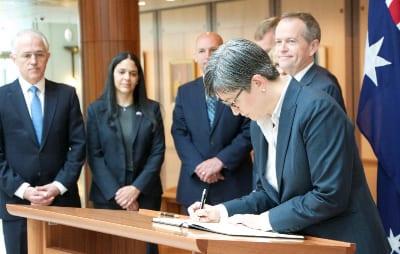 Senator Penny Wong signs