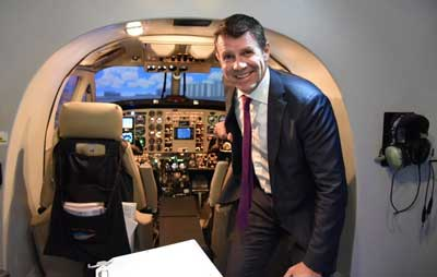Premier Mike Baird inspects the simulator