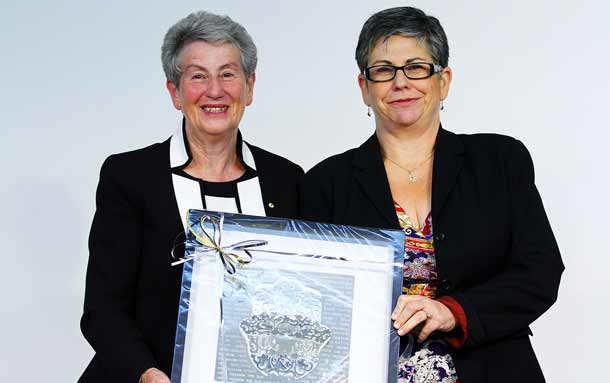 Nina Bassat [left] receives a gift from new JJC president Jennifer Huppert   Photo: Peter Haskin