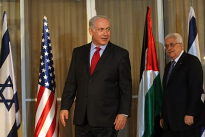 Israeli Prime Minister Benjamin Netanyahu stands with Palestinian Authority President Mahmoud Abbas at his Jerusalem residence Sept. 2010. Credit: Kobi Gideon/Flash90.