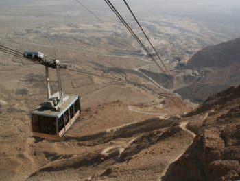 A cable car ascending the Masada fortress, one of Israel's most popular tourist destinations. Credit: K.Szajowski via Wikimedia Commons.