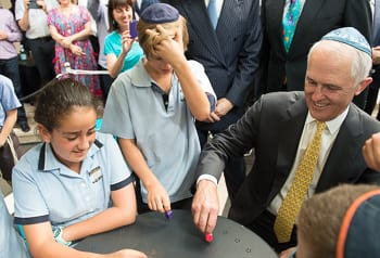 Political spin? Prime Minister Malcolm Turnbull spins the dreidel. Photo: Henry Benjamin/J-Wire