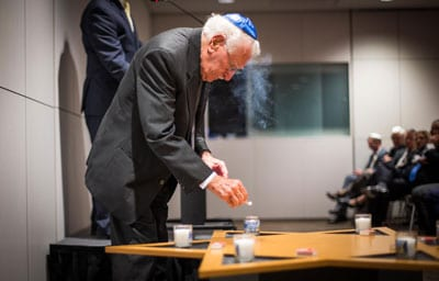 95-yr-old Auschwitz survivor Eddie Jaku lights a memorial candle