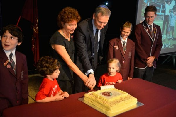 •	Emanuel students are joing by the Principal, Anne Hastings and Board Now! President, Grant McCorquodale in cutting the celebratory cake.
