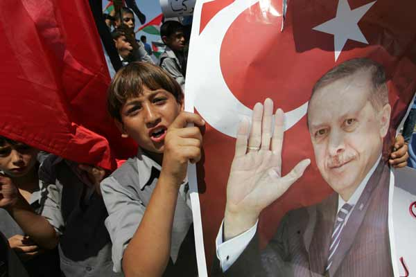 In Gaza City on Sept. 13, 2011, Palestinian students hold up pictures of then Turkish prime minister and now President Recep Tayyip Erdogan during a rally that urged Erdogan to visit the Hamas-ruled Gaza Strip. Erdogan's pro-Palestinian and anti-Israel views have been increasingly on display in recent years. Credit: Abed Rahim Khatib/Flash 90.