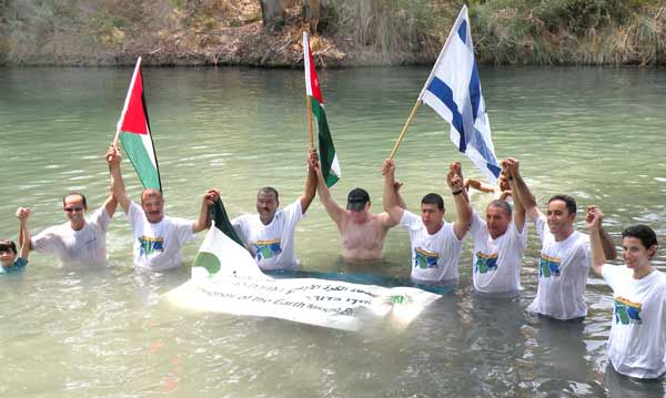 "Mayors, community reps and youth from Israel, Palestine and Jordan ""Jump in the Jordan"" calling for their governments to step up on the rehabilitation of the river"