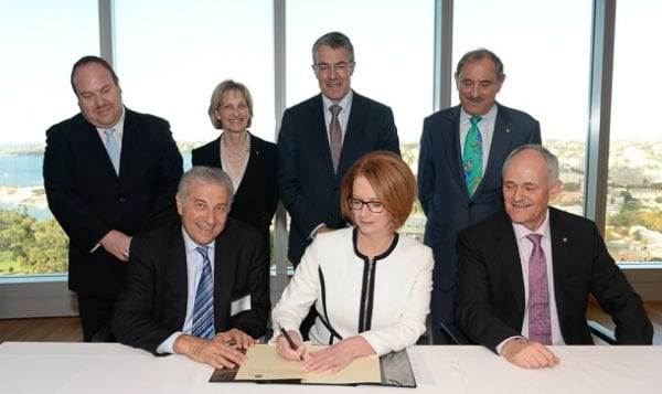Prime Minister Julia Gillard signs the London Declaration