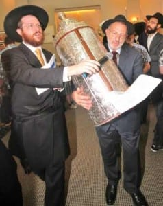 Rabbi Ritchie Moss and Rev Henry Amzalak dance with the new Torah