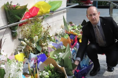 Jones lays flowers at the spot where Curtis Cheng was murdered
