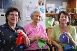 Knitters Renee Glass, Dora Krieger and Lea Friedlander
