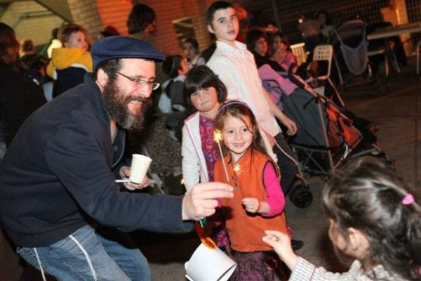 Yitzchok Bermeister celebrates Lag B'omer with his children