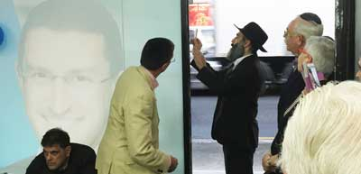 Rabbi Cohavi affixes the mezuzah