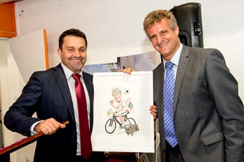 Opit presents Michael Evans with his caricature  Photo: Henry Benjamin/J-Wire