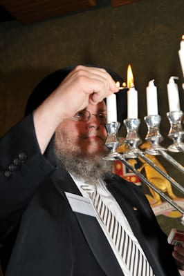 Rabbi Feldman lights the Menorah