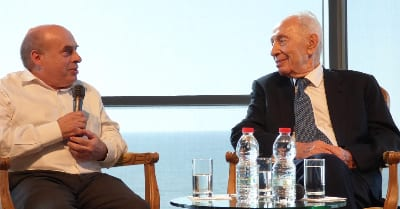 Jewish Agency Chairman Natan Sharansky and ninth President of Israel Shimon Peres in conversation at the Peres Center for Peace in Jaffa, Israel, April 7, 2015. Photo credit: David Shechter for The Jewish Agency for Israel.