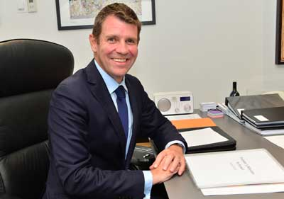 Premier Mike Baird studies the program   Photo: Henry Benjamin/J-Wire