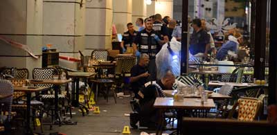 Israeli security forces at the scene where Palestinian terrorists opened fire and killed four people at the Sarona market in Tel Aviv on June 8. Credit: Gili Yaari/Flash90.