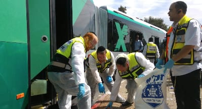 Israeli ZAKA volunteers respond to a bus attack in Jerusalem's Geula neighborhood on Oct. 13. Credit: Courtesy ZAKA.
