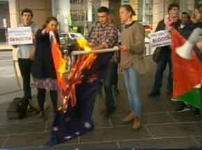 Burning the allegedly stolen Aussie flag   Pic: Courtesy Channel 7