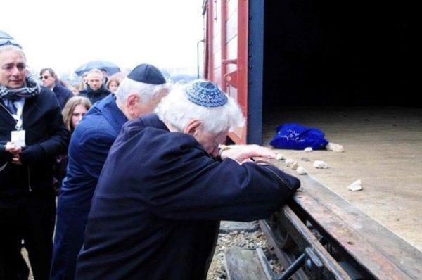 Alex and Frank Lowy and the wagon of Birkenau