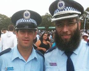 Rabbi Mendel Kastel [rt] on police duty