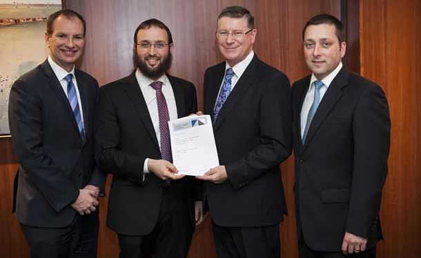 David Southwick MP, Rabbi Daniel Rabin, Vice President RCV, Premier Napthine, and  Mathew Guy MP holding the funding agreement