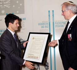 Victor Dominello present Charles Aronson with a certificate