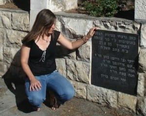 Carolyn examines the plaque