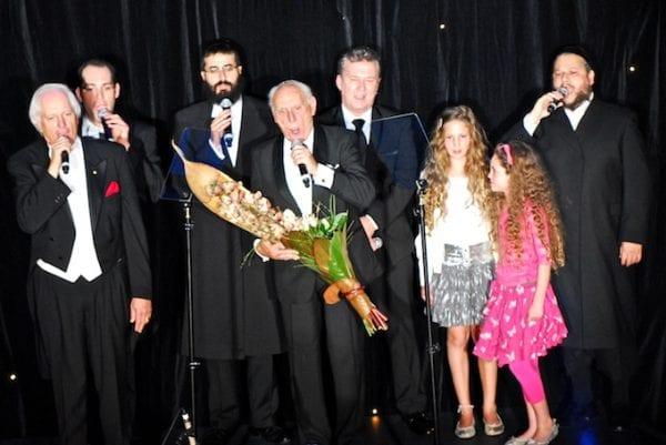l-r Shimon Farkas, Dov Farkas, Yehida Niassa, Bob Borowsly, Jimmy Barnes, Shimons granddaughters Tamar and Ethan and Cantor Helfgot