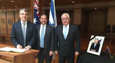 Shadow Attorney-General Mark Dreyfus, Labor Senator Glenn Sterle and Labor MP Michael Danby sign the book