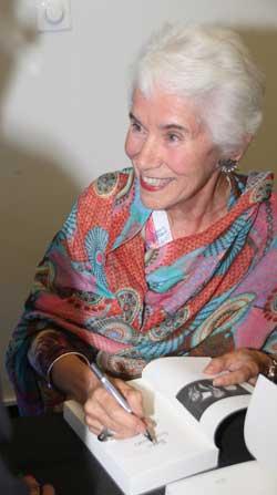 Eva Clarke signs a copy  Photo: Ben Apfelbaum
