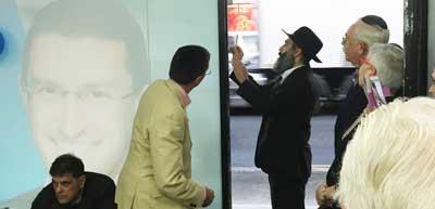 Rabbi Cohavi affixes the mezuzah